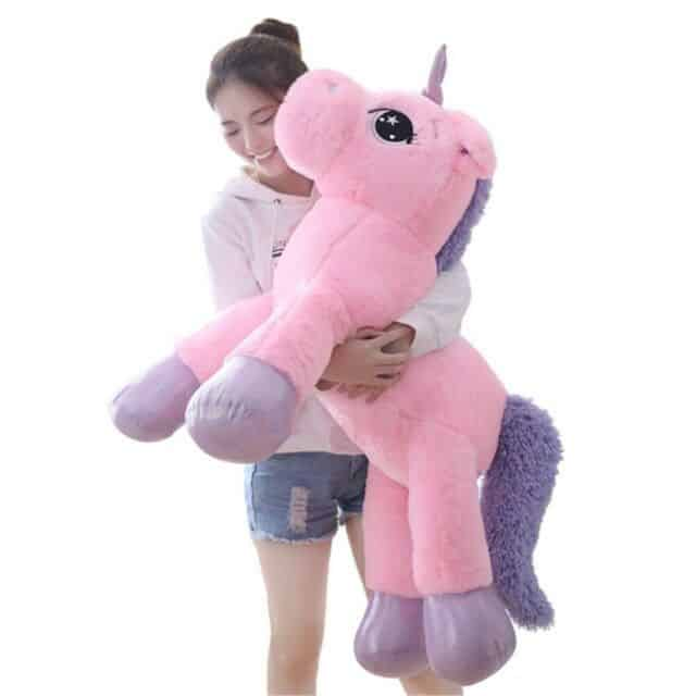 Girl With A Giant Pink Stuffed Animal