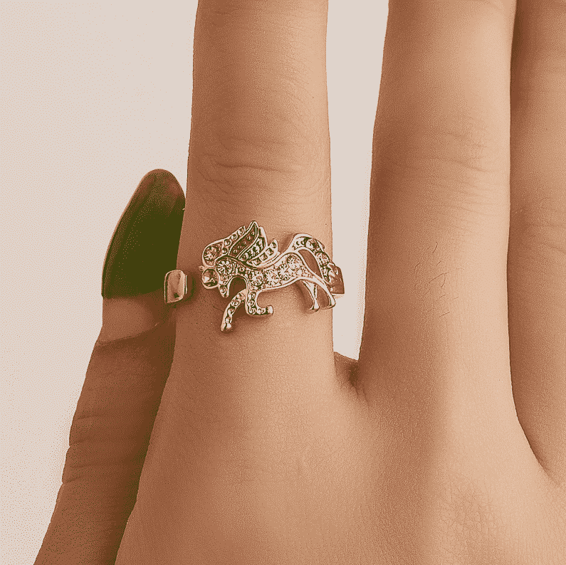 Woman Finger With A Sterling Unicorn Ring